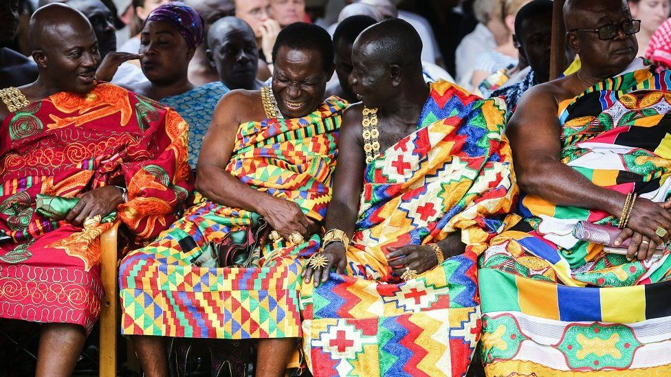 Tribal chiefs laugh during a visit of Britain's Prince Charles, Prince of Wales and his wife Britain's Camilla, Duchess of Cornwall to Osei Tutu II, the Asantahene or king of Ghana's Asante people, at Manhyia palace in Kumasi, Ghana on November 4, 2018