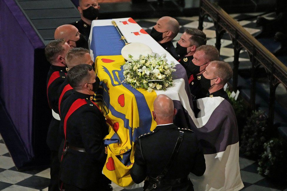 """The coffin is carried into St George's Chapel during the funeral of Britain""""s Prince Philip, who died at the age of 99, at Windsor Castle, Britain, April 17, 2021."""