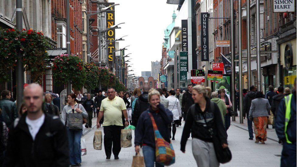 Shoppers walk down Henry Street in Dublin