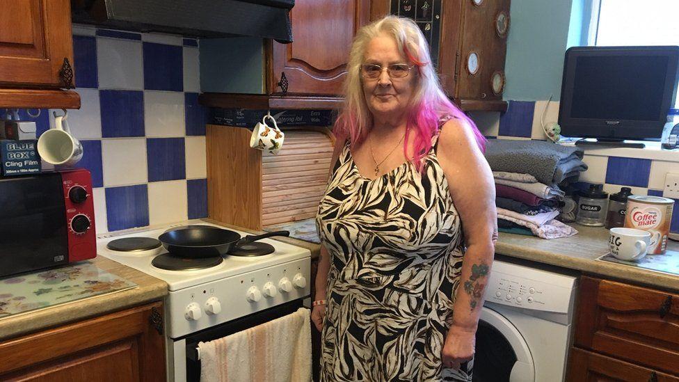 Glenda Kenyon by her kitchen hob