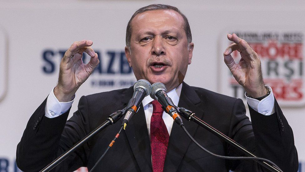 """Turkey""""s President Recep Tayyip Erdogan gestures as he speaks to supporters of his ruling Justice and Development Party as they rally to denounce violence by Kurdish rebels"""