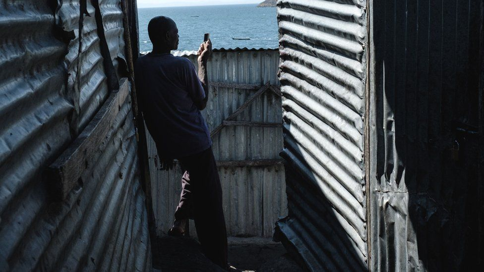 A man using a mobile phone in Kenya