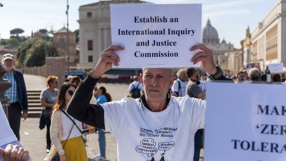 Protesters demonstrate in support of the victims of violence by paedophile priests, near the Vatican on 3 October 2018