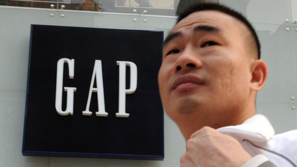 Man walks past Gap store in China