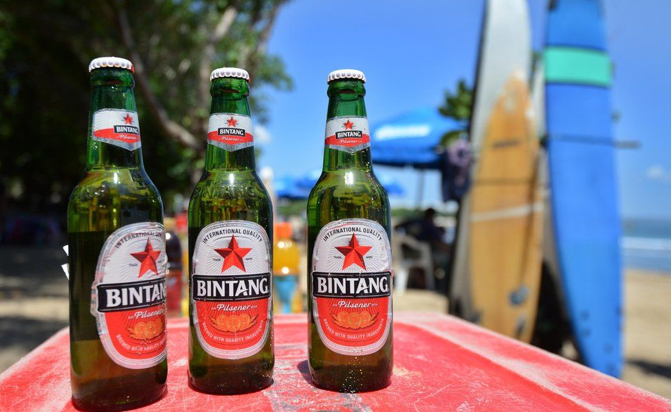Bottles of beer on a cooler on a beach in Bali
