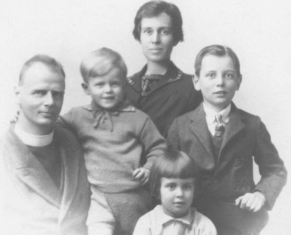 A black and white picture showing the Reverend Hubert Warren with his wife and three of his children