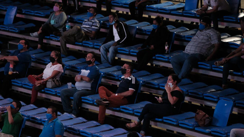 The audience sits apart from each other at a boxing match in Managua during the pandemic