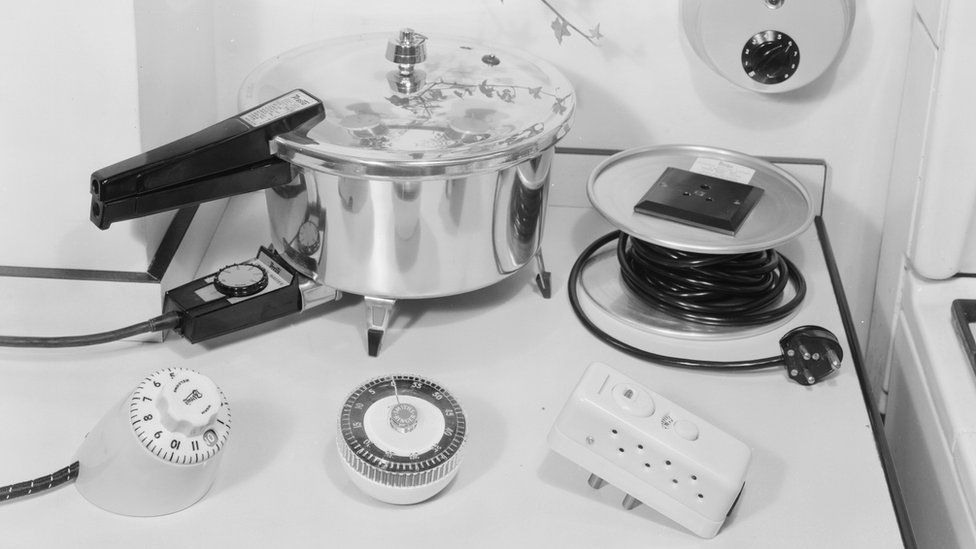 7th October 1959: A pressure cooker, time switch, extension and timer. Modern Woman - pub. 1959
