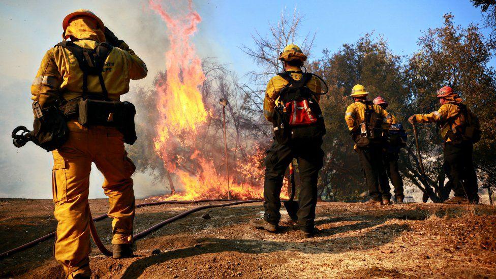 Firefighters battle a blaze on November 10, 2018 in Malibu, California