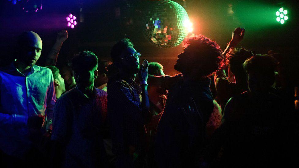 Men dancing in Kitty Su nightclub