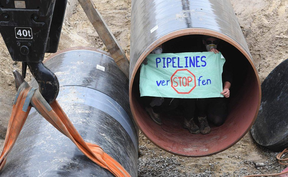 Activists inside the pipeline