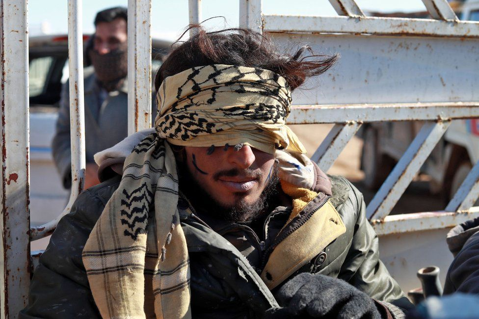 A suspected IS member in detention in the Syrian village of Baghouz, near the Iraqi border, 30 January