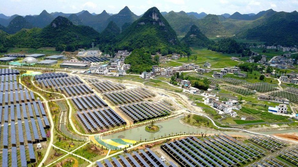 Greenhouses with solar panels on their roofs, in Yang Fang village in Anlong, in China's southwest Guizhou province