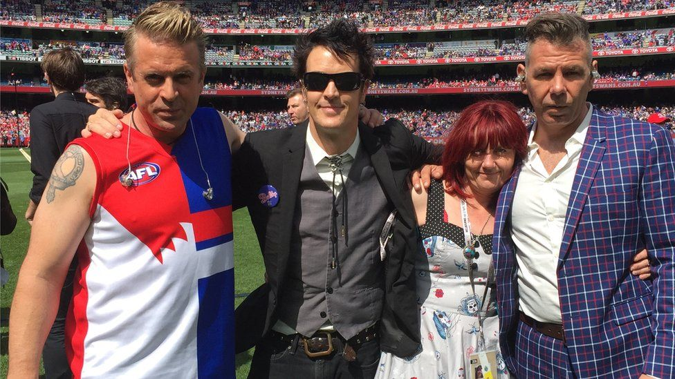 Ms Harvey with The Living End at the MCG in 2016, when the ban performed at the AFL Grand Final
