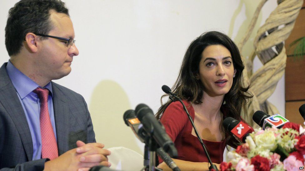 Human rights lawyers Amal Clooney, right, and Jared Genser