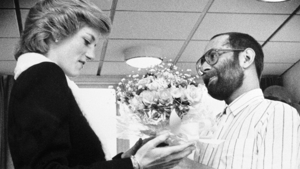 File photo dated 24/02/1989 of the Princess of Wales being presented with a bouquet by patient Martin Johnson at Mildmay Hospital in east London