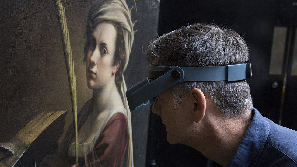 Man examining painting