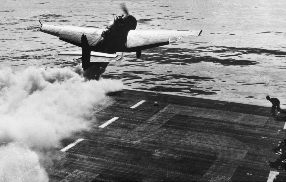A Grumann TBF Avenger makes a jet-assisted take-off in the Pacific in World War Two