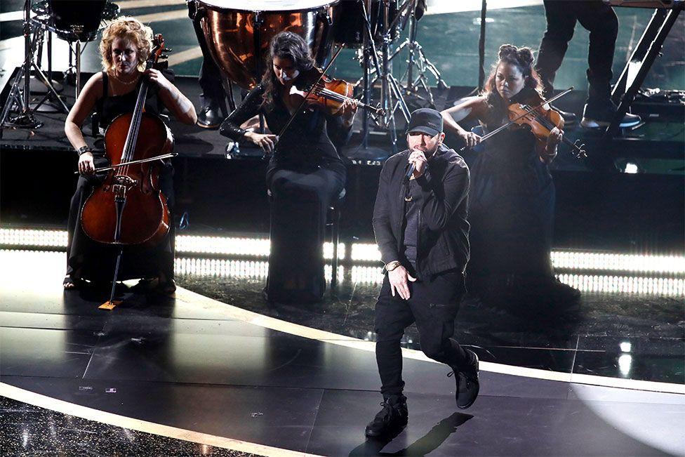 Eminem performs on stage