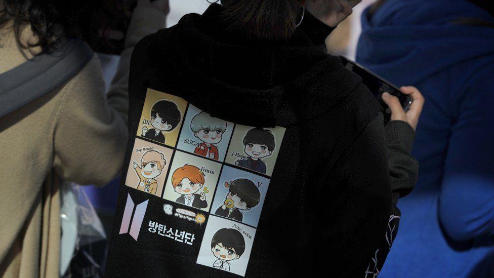 Fan in BTS hoodie