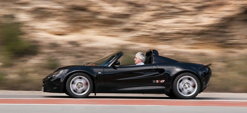 Sports car on road near Sitges, Spain, 2016