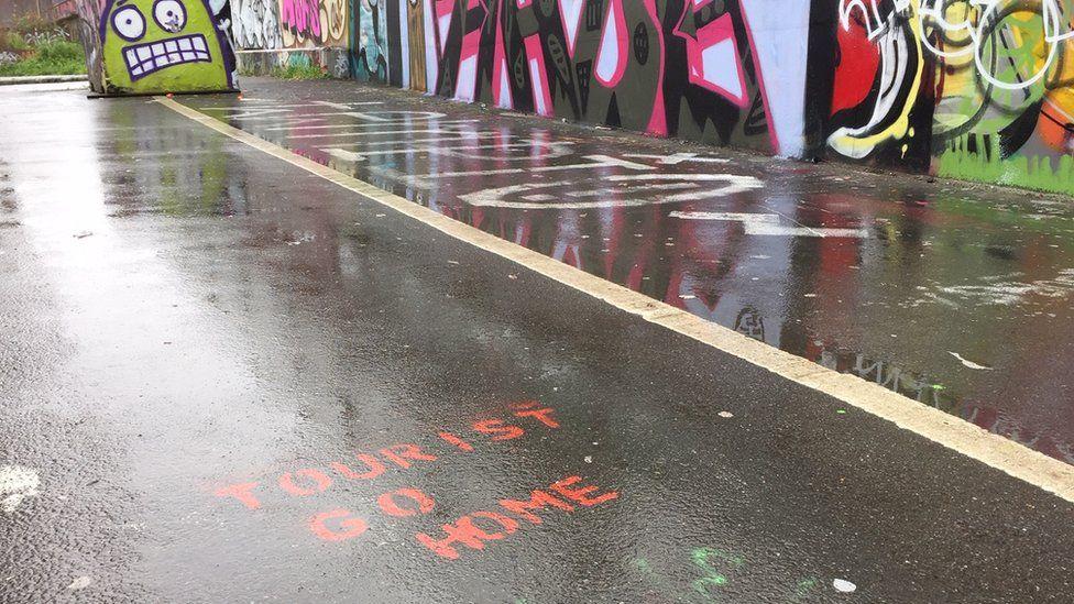 'Tourist go home' graffiti in Shoreditch