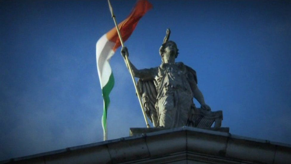 An Irish tricolour flies above Dublin's General Post Office (GPO) - the headquarters of the Irish rebellion against British rule in Ireland in 1916