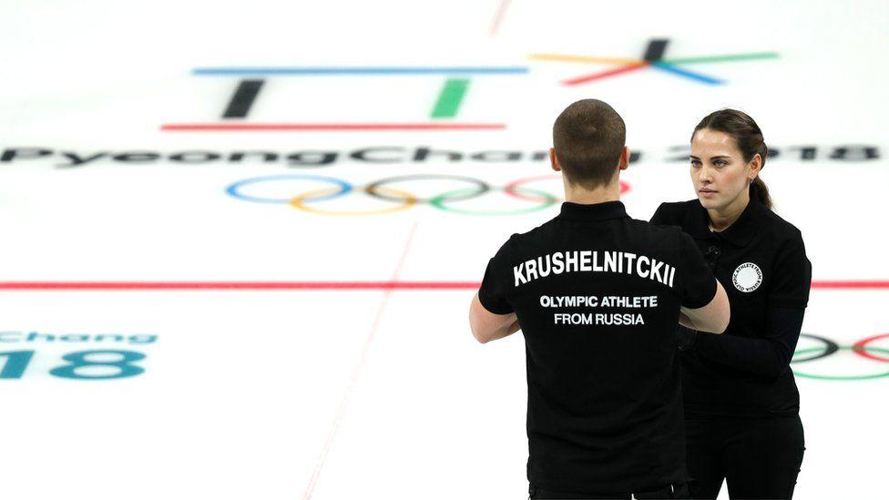 Anastasia Bryzgalova and Aleksandr Krushelnitckii of Olympic Athletes from Russia talk during their game