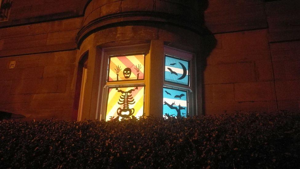 Skeleton figure in tenement window