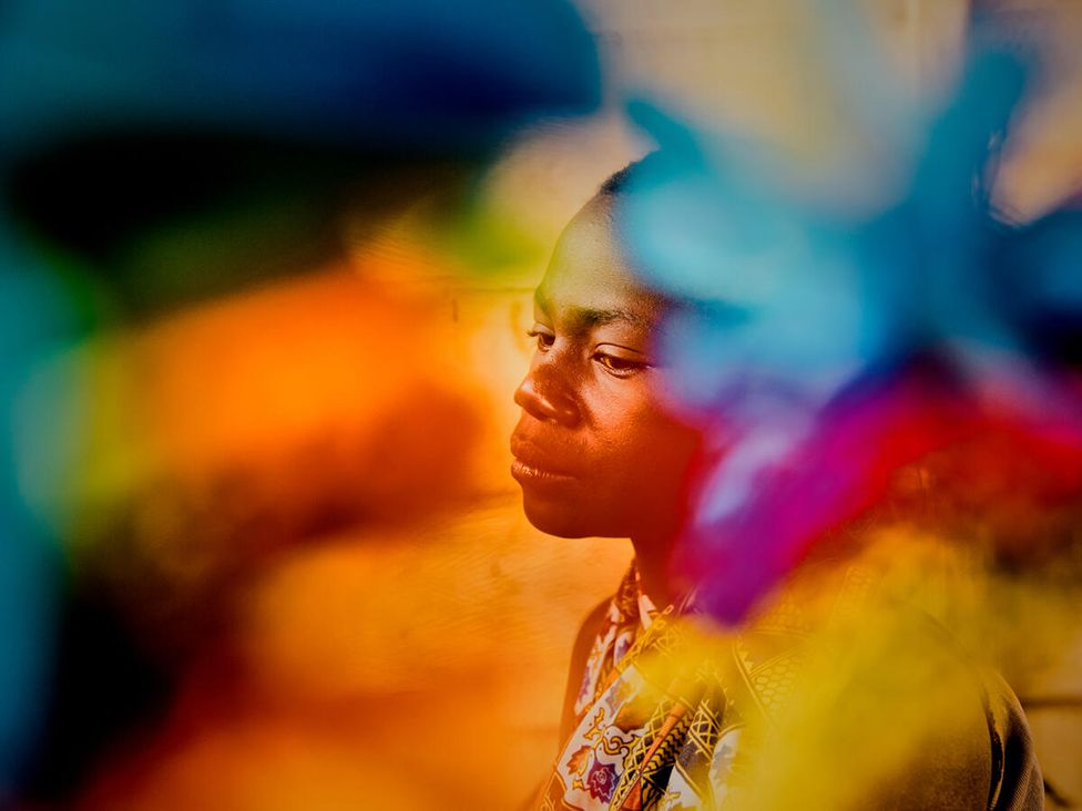 Emilie, 15, sits for a portrait in Djugu Territory, Ituri Province. Democratic Republic of Congo