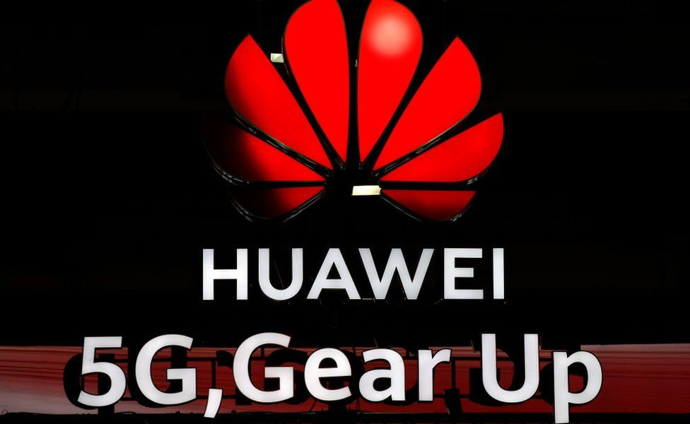 Illuminated Huawei and 5G signs are on display during the 10th Global mobile broadband forum hosted by Chinese tech giant Huawei in Zurich on October 15, 2019.