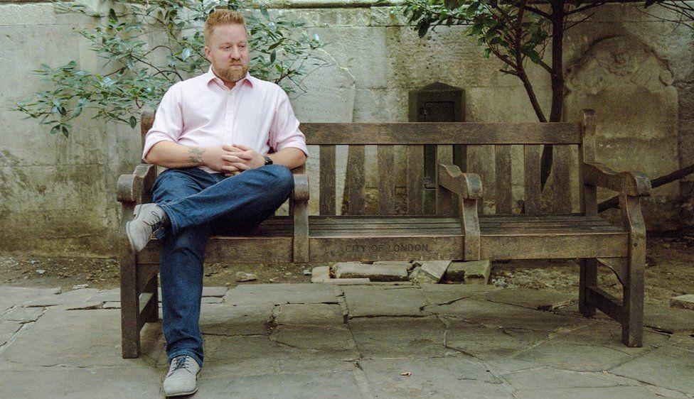 Man sat alone on a bench