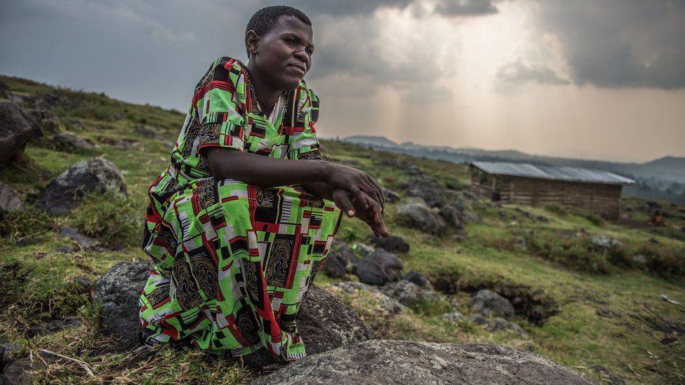 Anette Ntakirutimana sits on a rock