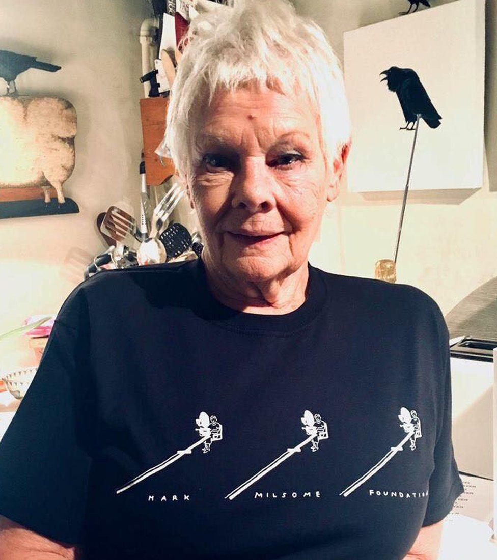 Dame Judy Dench wearing a t-shirt of the Mark Milsome Foundation