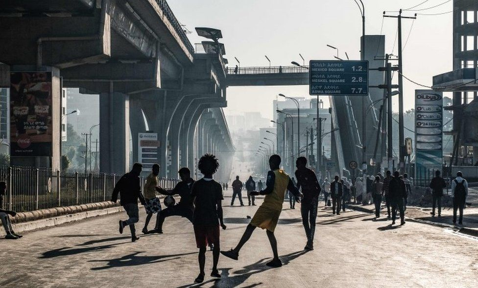 People play football in Addis Ababa on 3 February 2019 during the third Car Free Day