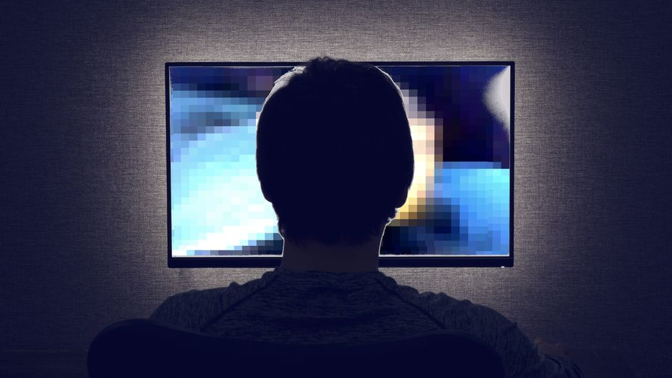 man looking at explicit video