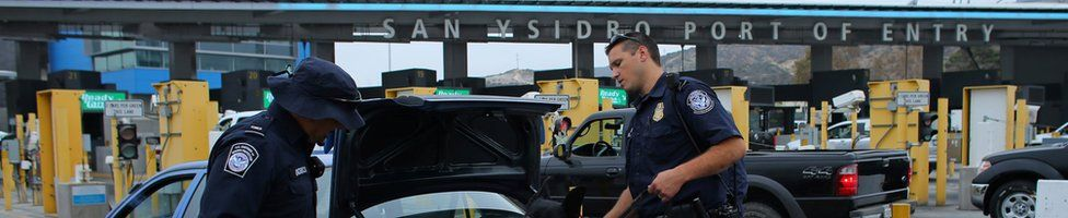 US customs and border patrol officers inspect a vehicle entering the US from Mexico at the border crossing in San Ysidro, California, United States, 14 October