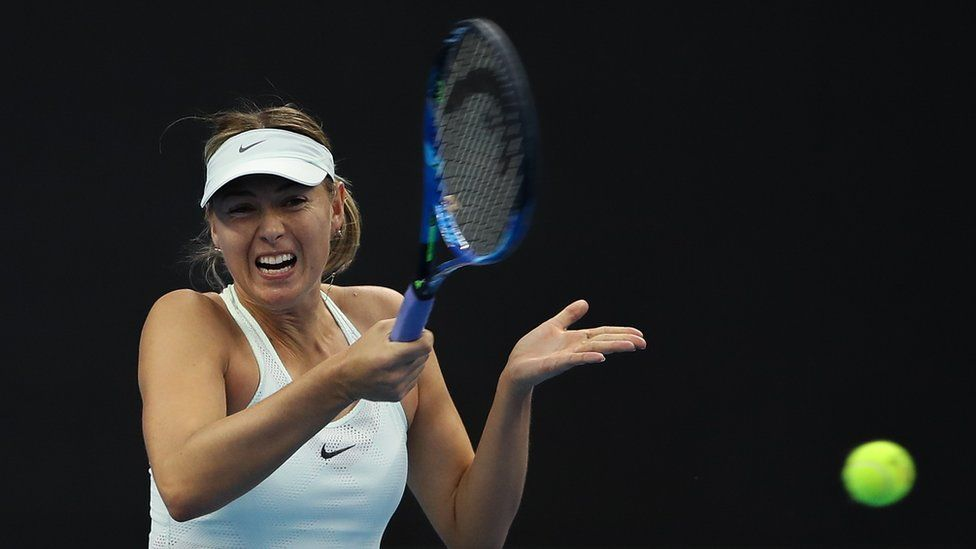 Maria Sharapova of Russia returns a shot during the Women's singles of 2017 China Open