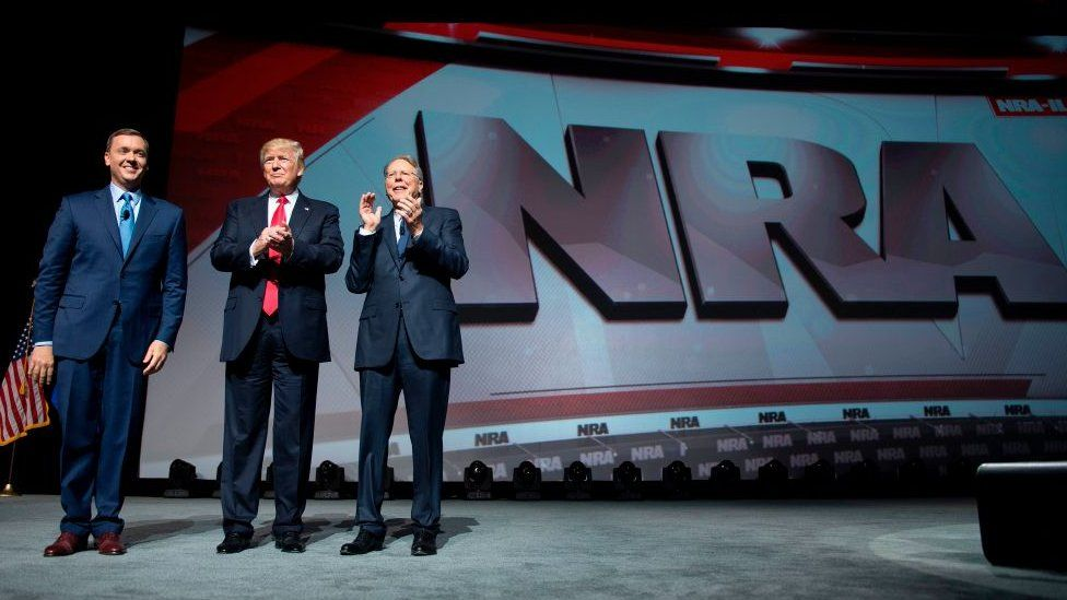 US President Donald Trump stands with National Rifle Association (NRA) President Wayne LaPierre (R) and NRA-ILA Executive Director Chris Cox (L) during the NRA Leadership Forum in Atlanta, Georgia on April 28, 2017.