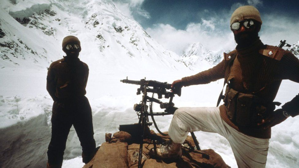 Pakistani soldiers stand June, 1989 in Kashmir near the Pakistan-India border