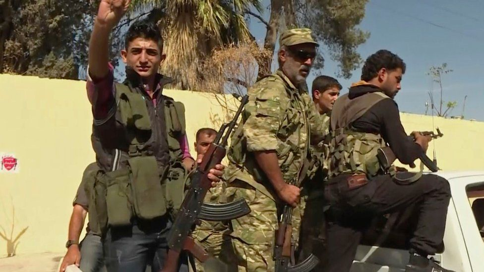 Turkish-backed Syrian opposition forces patrol in Dabiq
