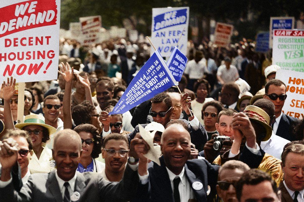 Marchers cheer and wave placards at the Civil Rights March on Washington