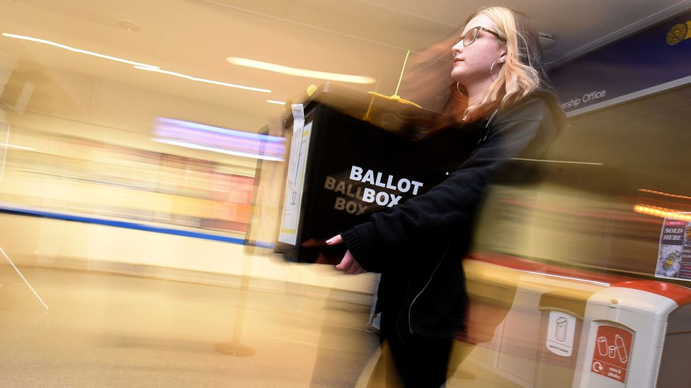 Woman carrying a ballot box