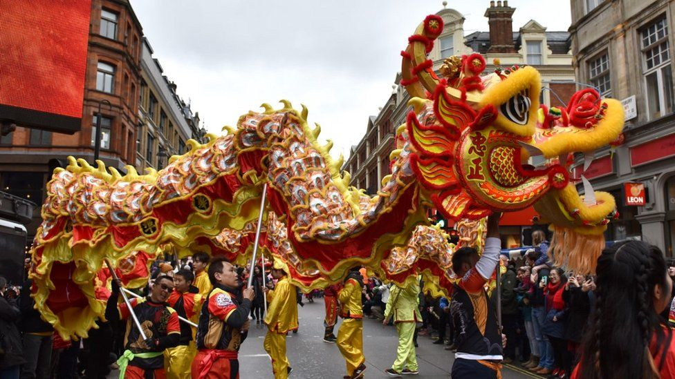 Chinese New Year: Pigs, dragons and pandas on England's streets - BBC News