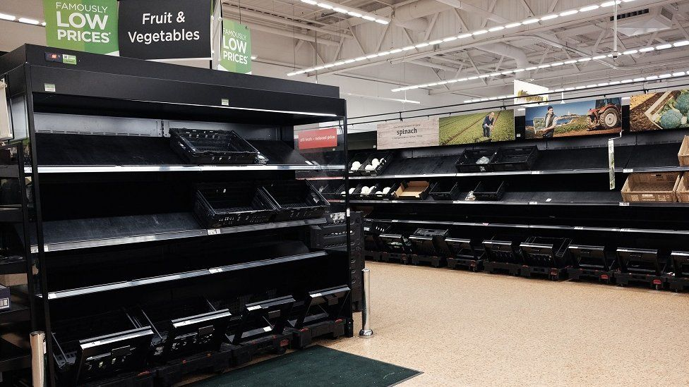 An empty fruit and vegetable aisle in an Asda supermarket
