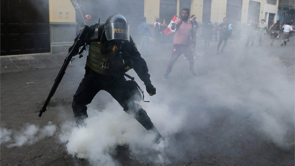 Protesters clash with police during a march after Peruvian President Pedro Pablo Kuczynski pardoned former President Alberto Fujimori in Lima, Peru, December 25, 2017