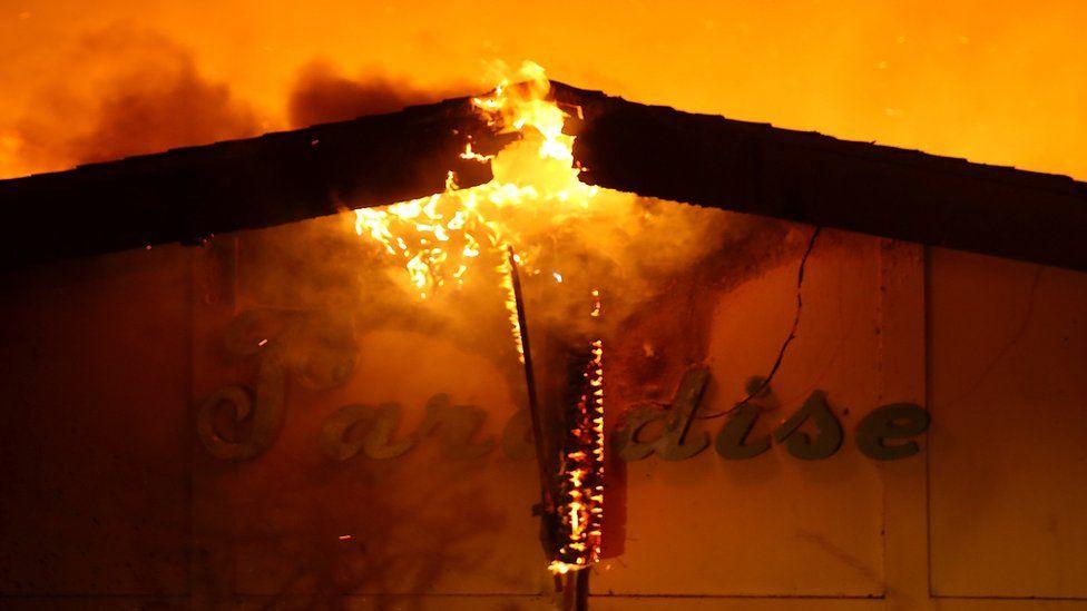 Burning sign saying Paradise