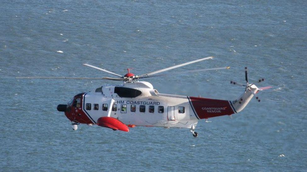 Coastguard helicopter fling over sea