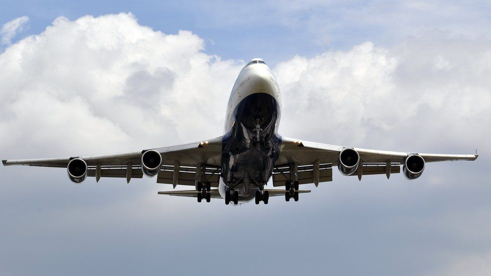 Plane coming into land at Heathrow Airport