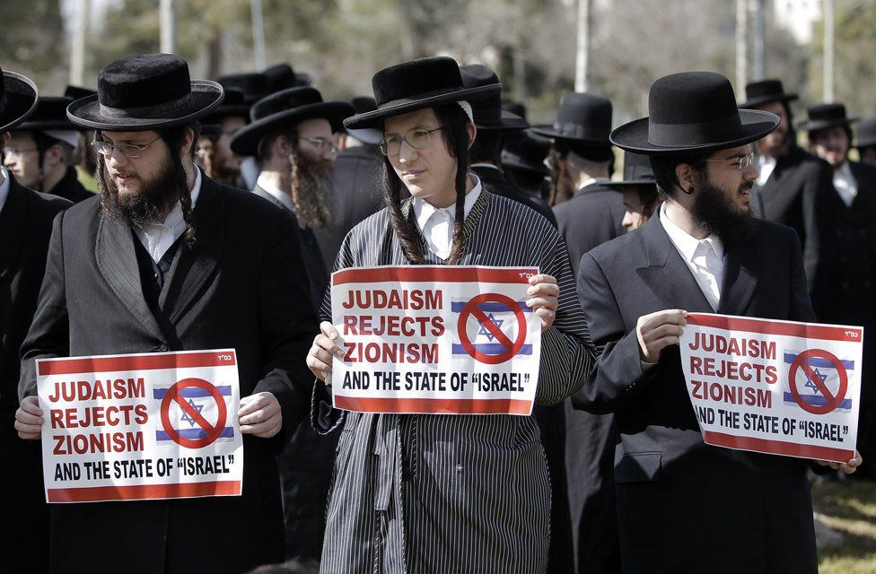 Ultra-Orthodox Jewish protestors, some of them belonging to Neturei Karta, a small faction of anti-Zionist ultra-Orthodox Jews who oppose Israel's existence, hold placards during an anti-zionist demonstration outside the US consulate in Jerusalem